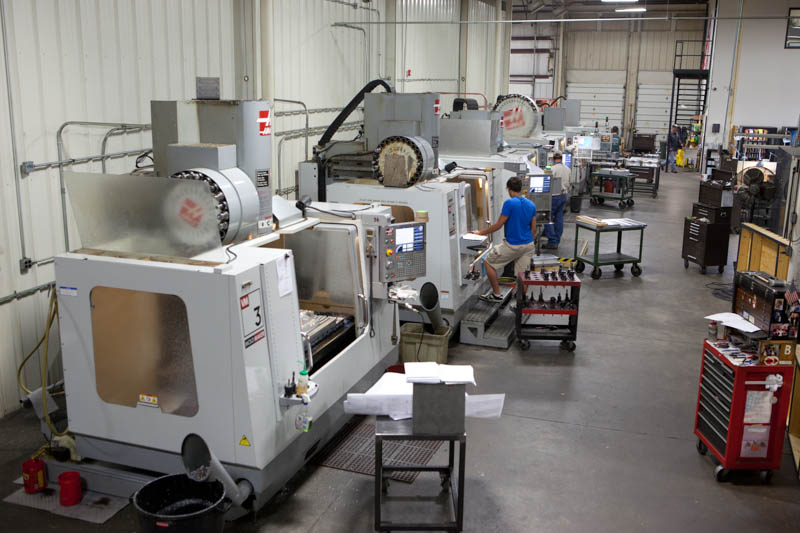 One row of CNC mills in our spacious, climate-controlled facility.